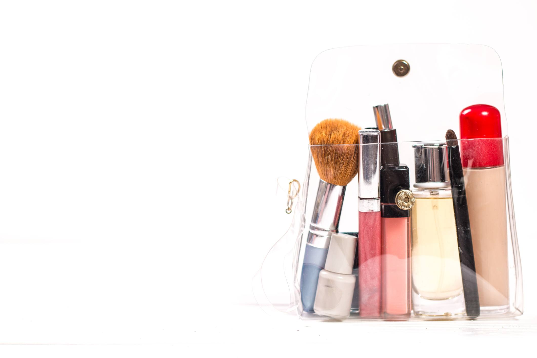 makeup products on wooden background