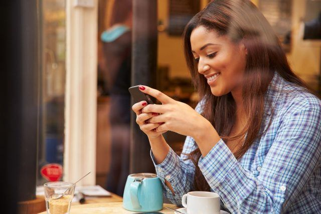 woman using smartphone and smilling