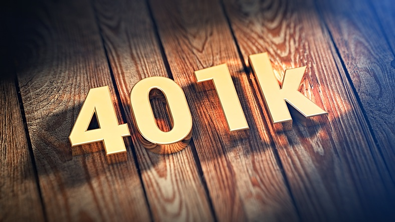 """The sign """"401k"""" is lined with gold letters on wooden planks"""
