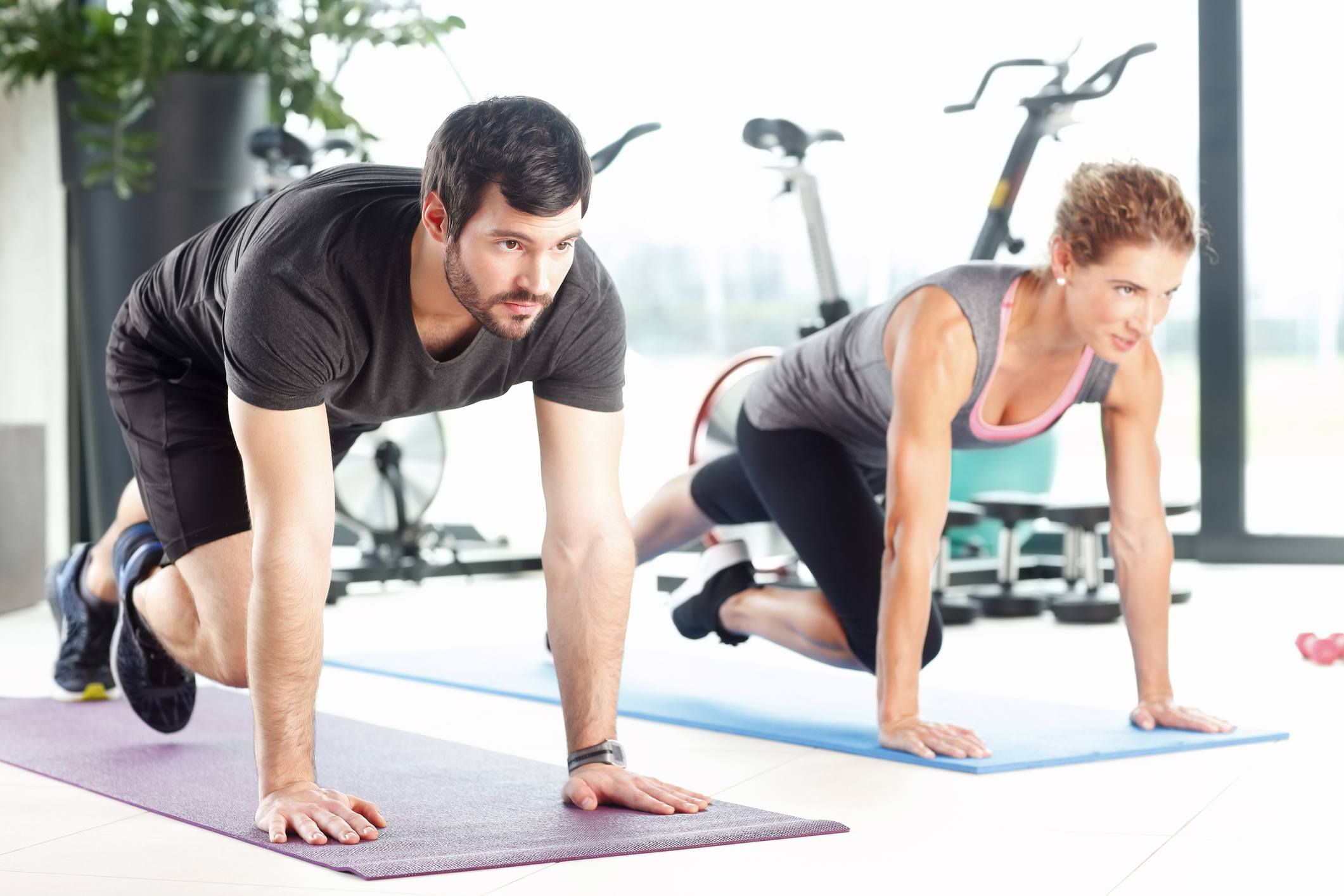 man and woman doing plank exercises