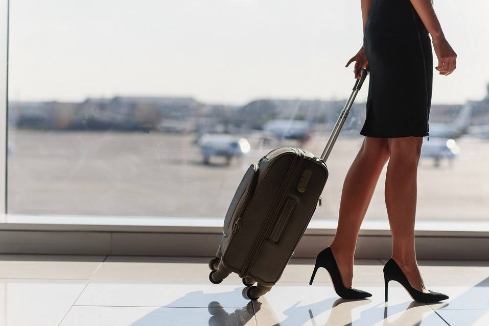 legs of elegant woman going on business trip