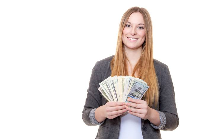 Woman holding a stack of money