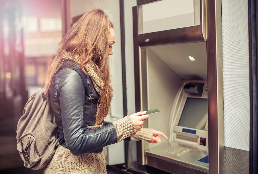 woman withdrawing money from ATM
