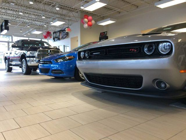 A line of FCA products on display at a local dealership showroom floor