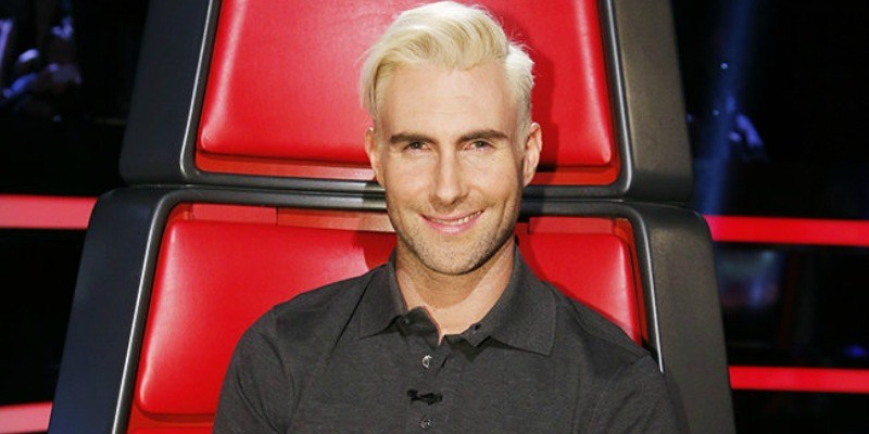 Adam Levine sitting in the chair on The Voice