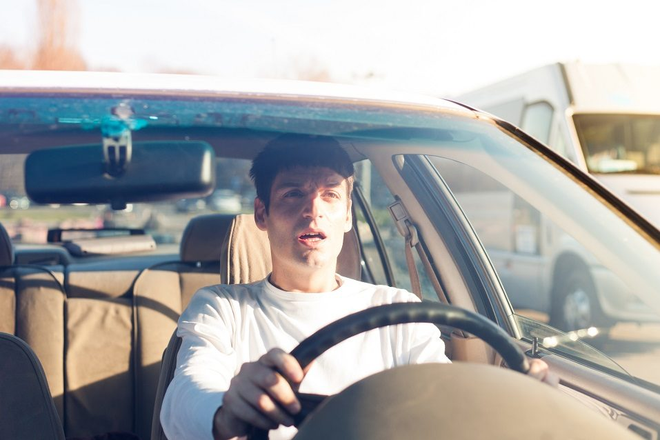 Young man driving a car