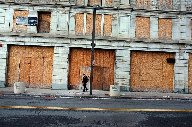 A man walks through struggling downtown Binghamton