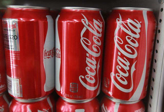 Cans of Coca-Cola in a row.