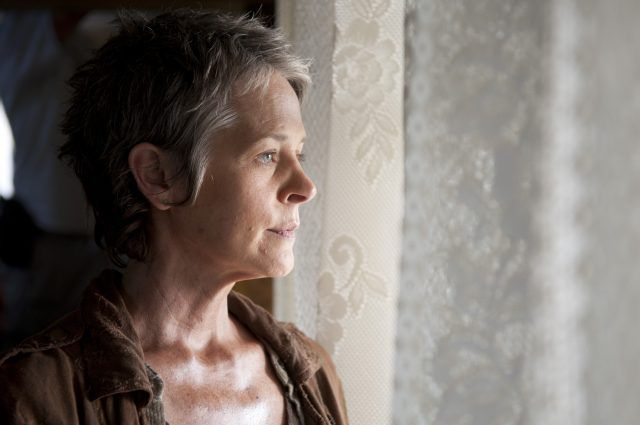Carol (Melissa McBride) stares out a window in a scene from Season 5 of 'The Walking Dead'