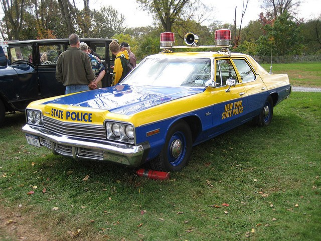 Blue and yellow Dodge Monaco in use as a New York State Police car