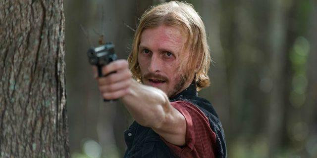 Dwight (Austin Amelio) points a gun in a scene from 'The Walking Dead'