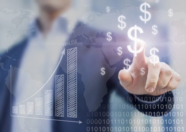 Businessman presenting financial analysis with charts