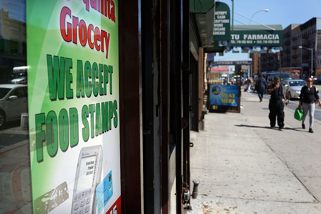 food stamps sign on a grocery store window