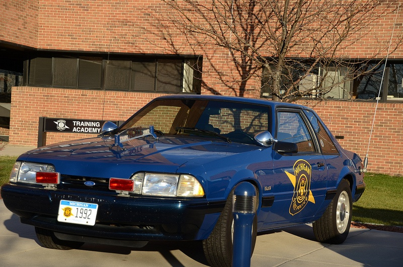 Blue Ford Mustang cop car