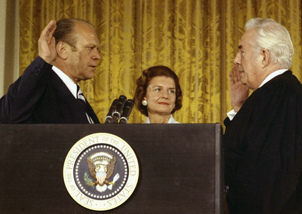 Supreme Court Chief Justice Warren Burger (R) swears in President Gerald Ford