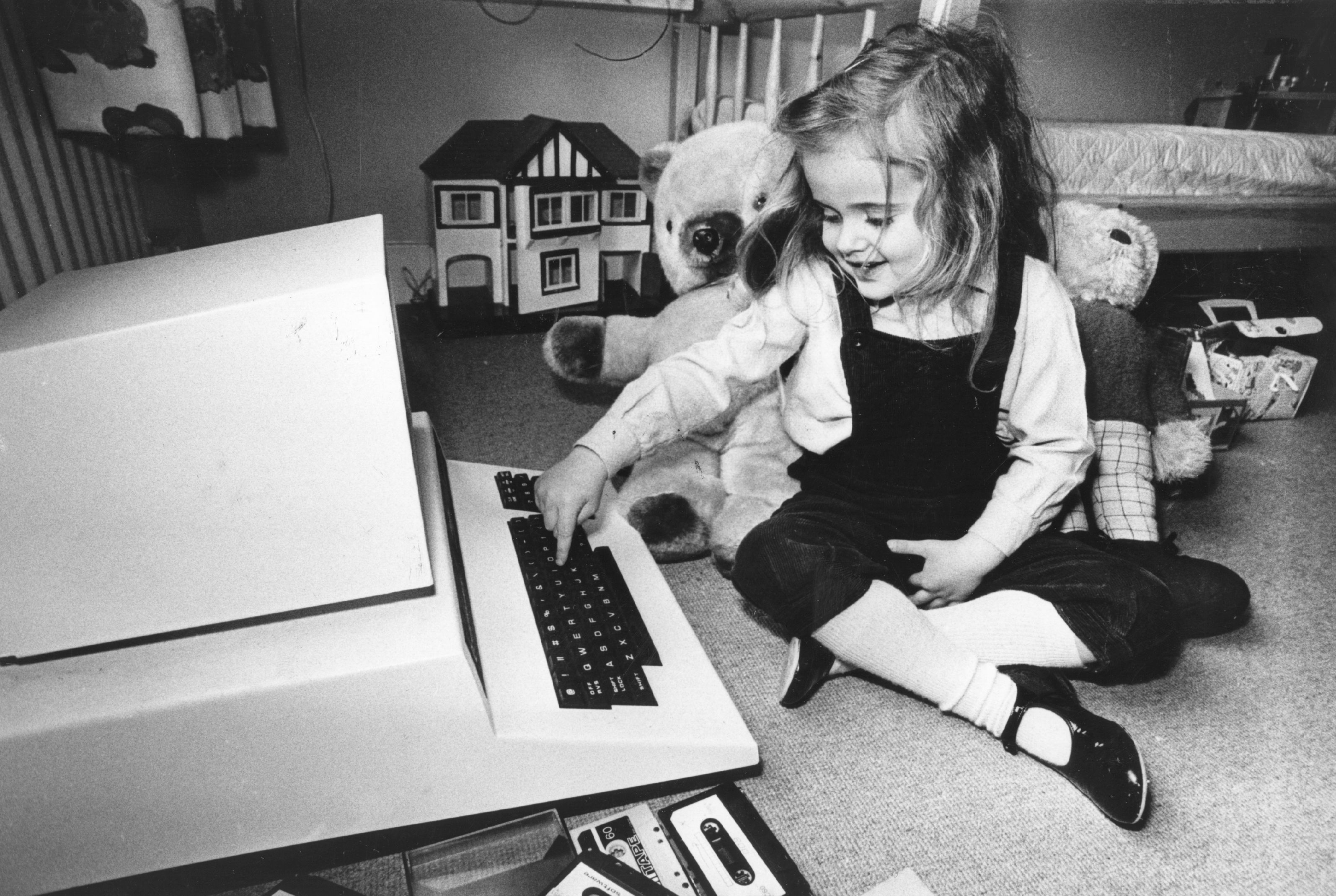 girl playing with a computer