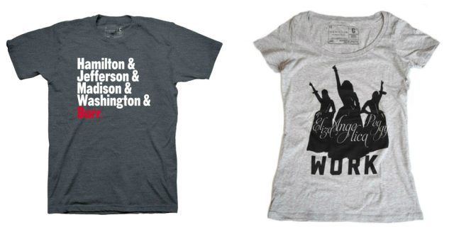A dark grey t-shirt that reads 'Hamilton & Jefferson & Madison & Washington & Burr' and a light grey t-shirt that shows the outline of the Schuyler sisters and says 'Work'