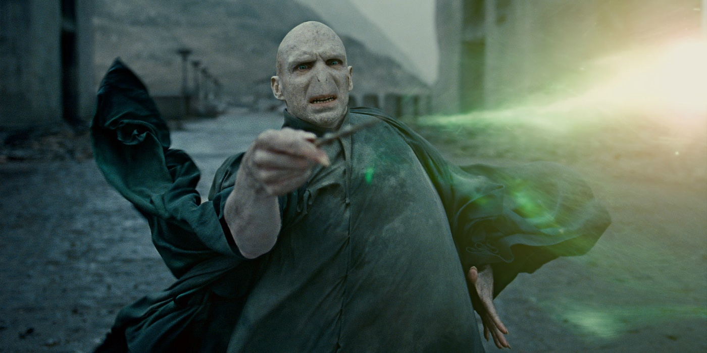 Voldemort casting a spell with his wand.