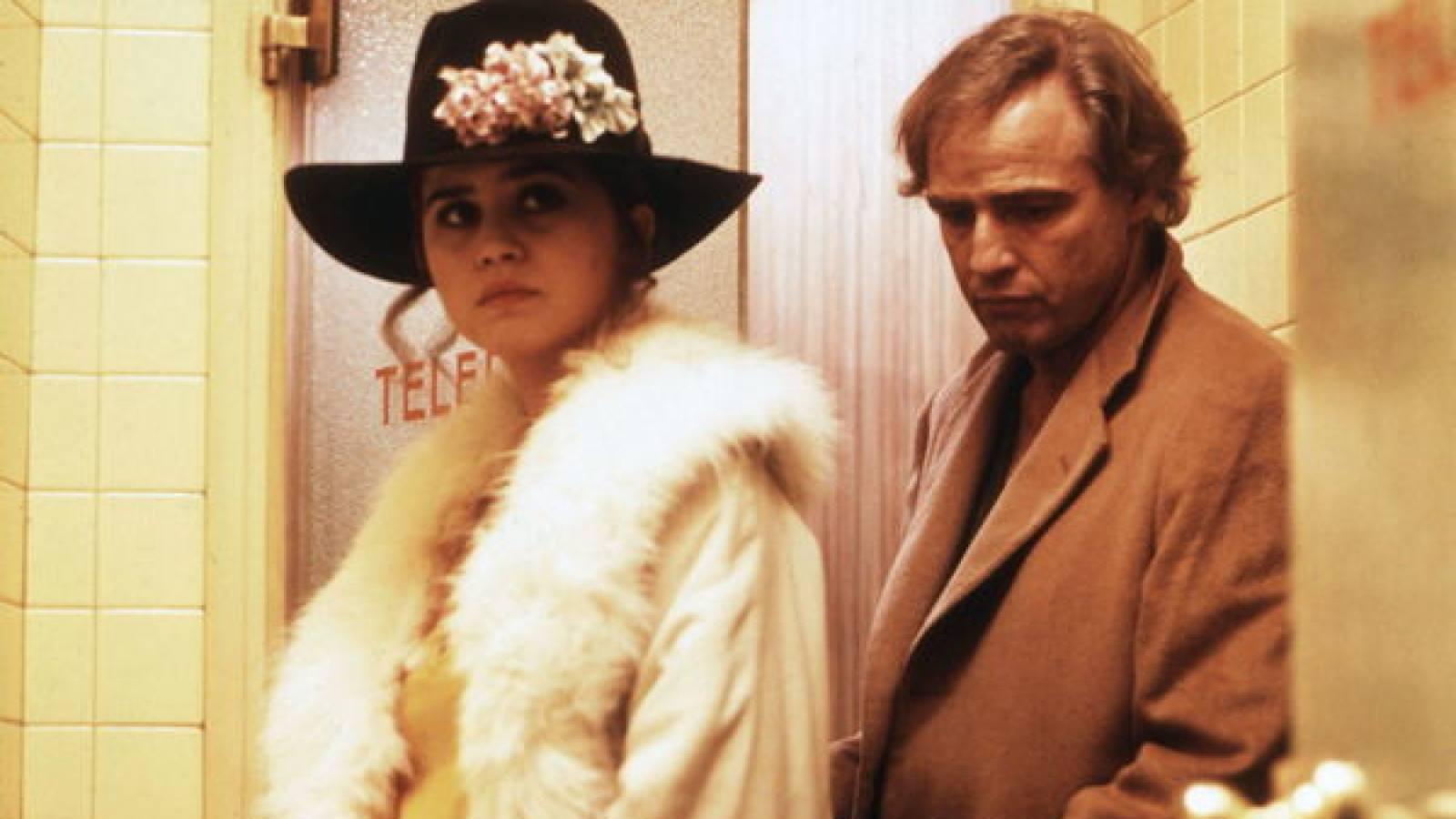 A woman in a black flowered hat with a white fur jacket Last Tango in Paris