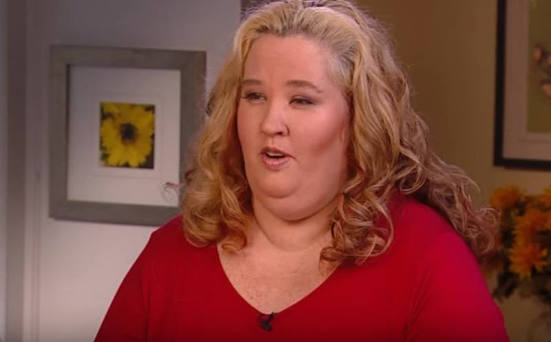 Mama June wearing a red shirt in an interview with ET