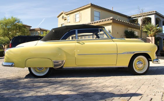 A yellow 1951 Chevrolet Styline DeLuxe, one of Steve McQueen's cars that was also owned by Rick Harrison of Pawn Stars