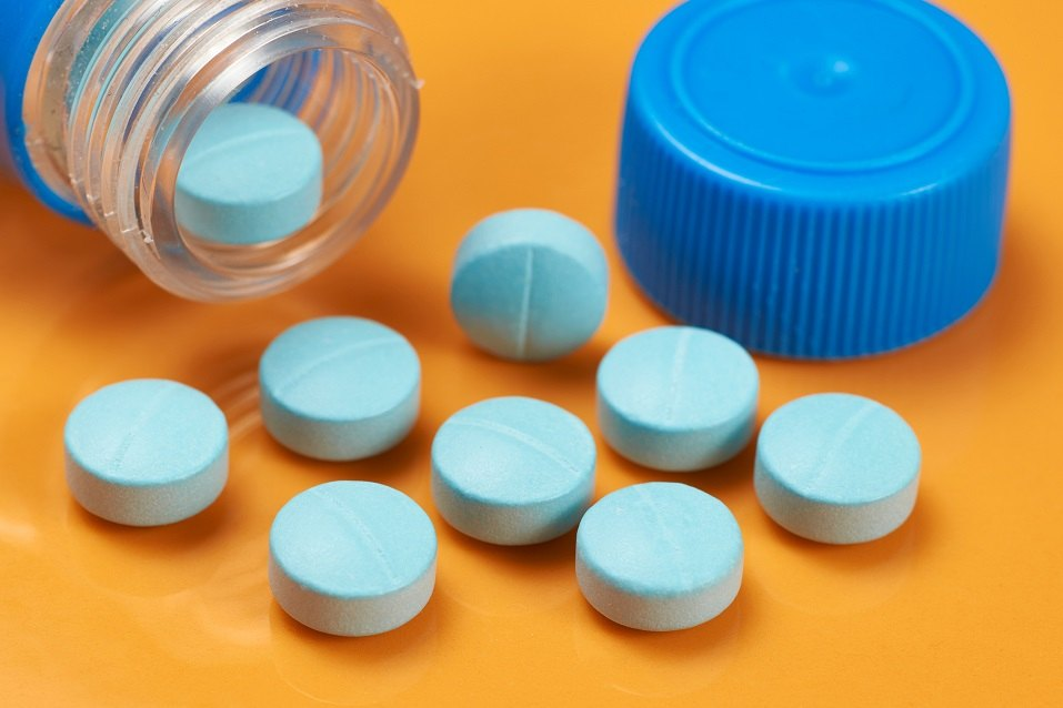 medicinal tablets with blue container