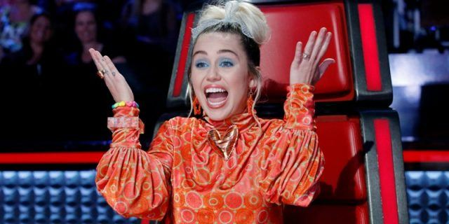 Miley Cyrus looking shocked on The Voice.