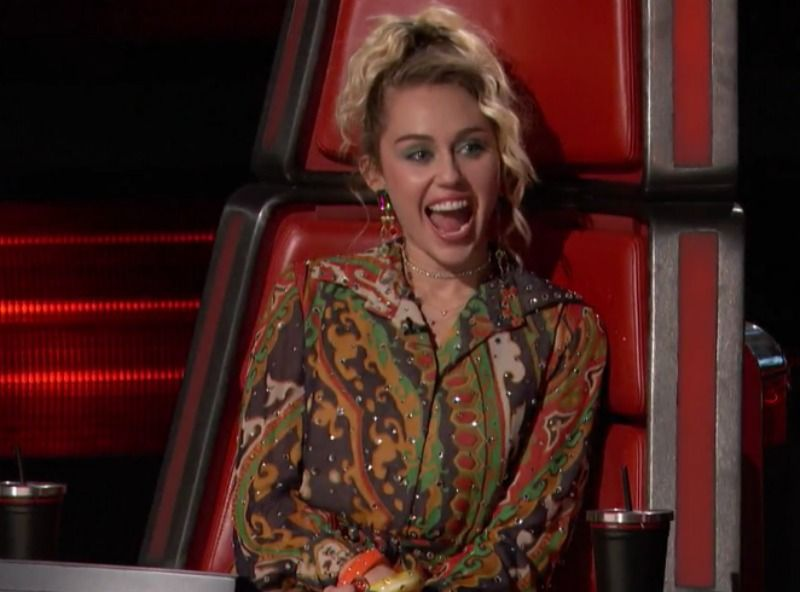 Miley Cyrus laughing on the voice.