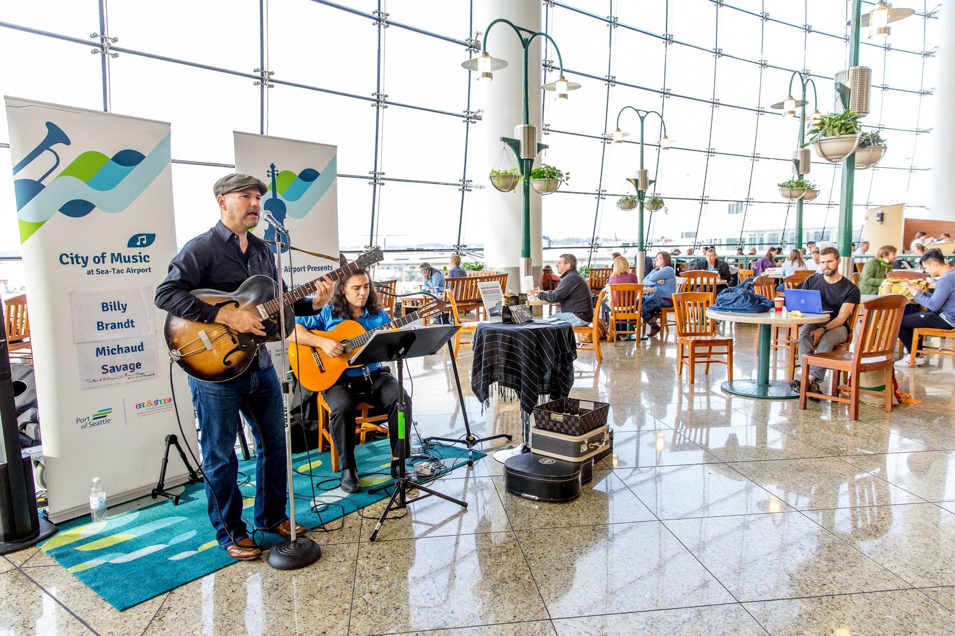 musicians perform at sea-tac airport