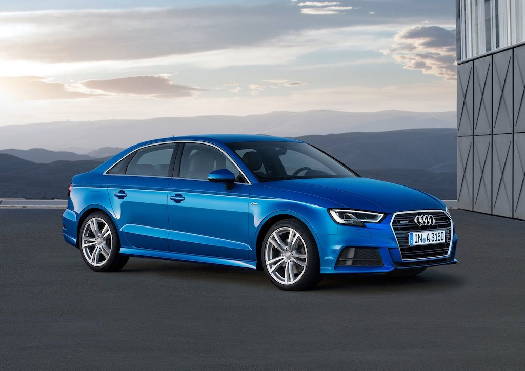 A bright blue 2017 Audi A3 sits parked