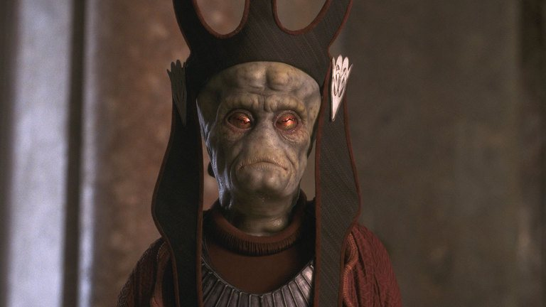 Nute Gunray, wearing a black crowned hat, and a red robe
