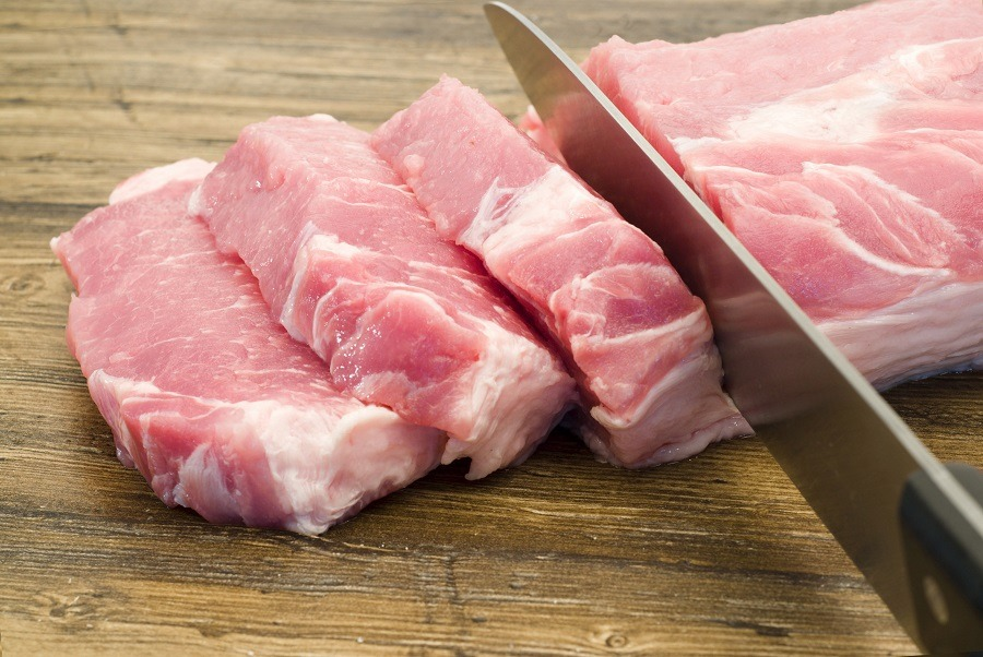 Knife cutting pork tenderloin