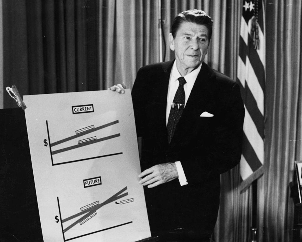 President Ronald Reagan holding a chart