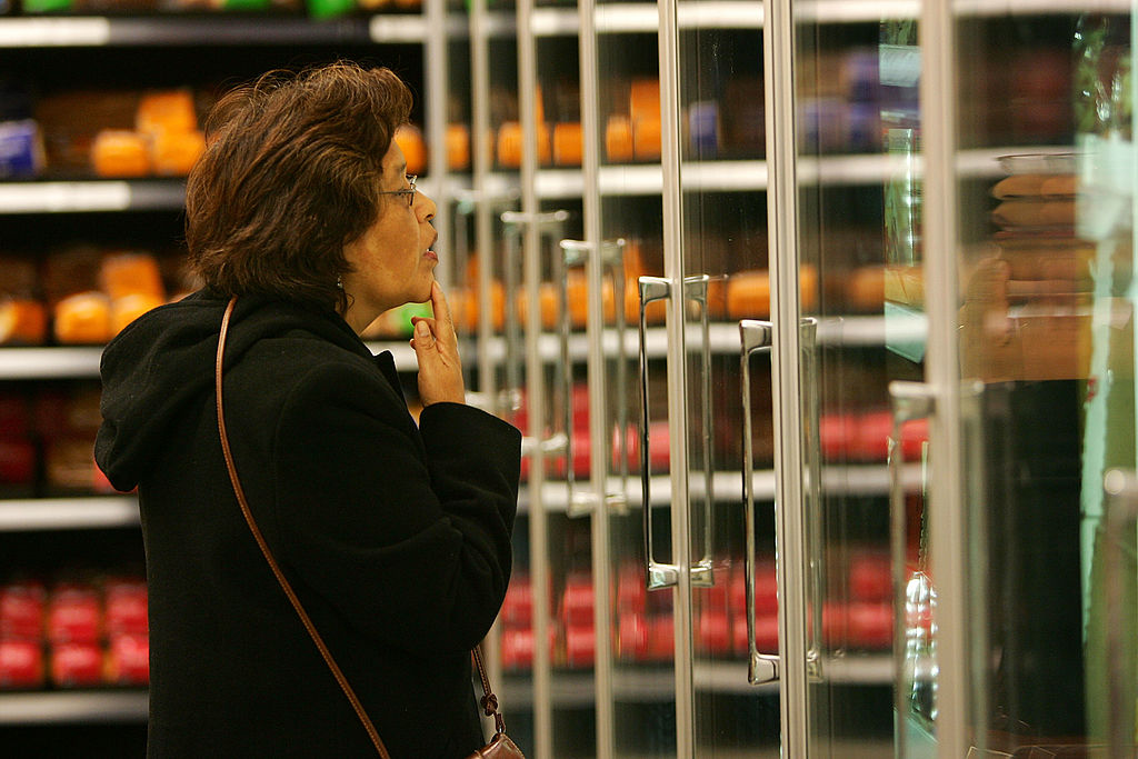 woman shopping in the frozen food aisle