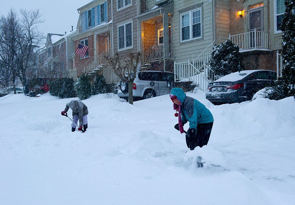 People shoveling snow in Virginia.
