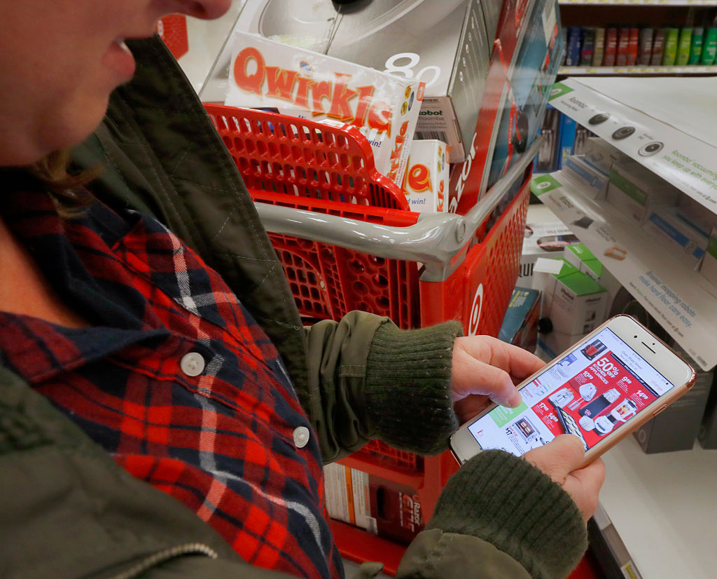 A shopper checks out an advertisement on her smartphone