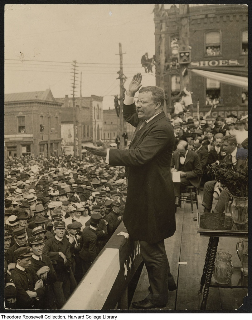 Theodore Roosevelt speaking to a large crowd