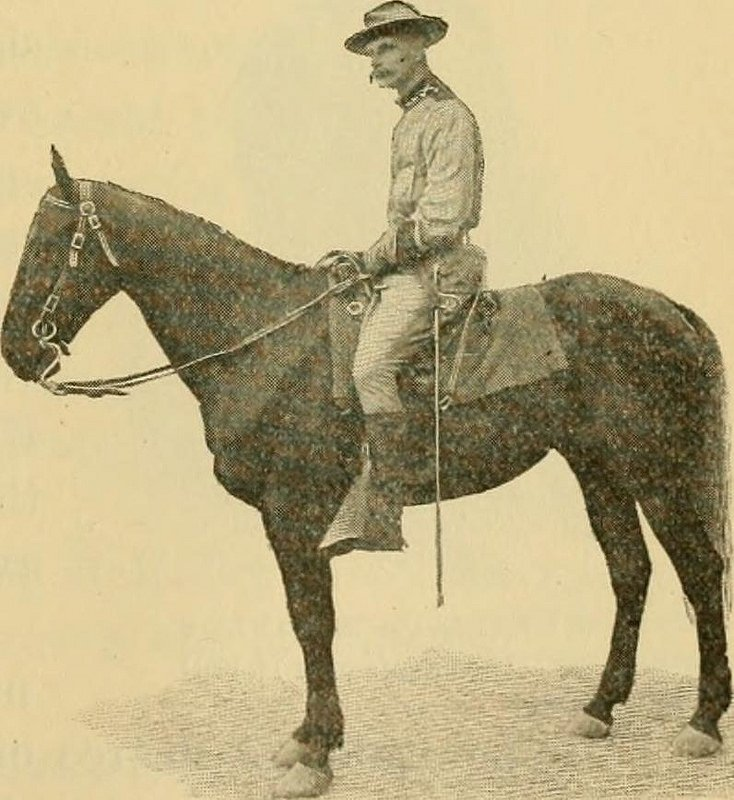 Theodore Roosevelt Jr. sits atop a horse