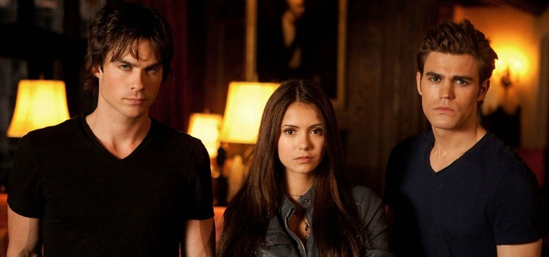 Ian Somerhalder, Nina Dobrev, and Paul Wesley stand next to each other in The Vampire Diaries
