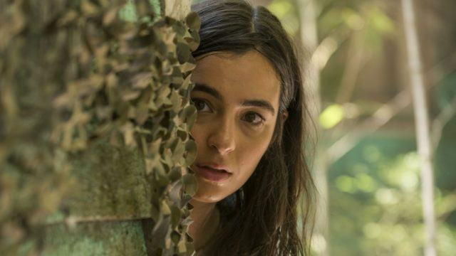 Tara (Alanna Masterson) peers out from behind a tree in a scene from 'The Walking Dead' Season 7 episode, 'Swear'