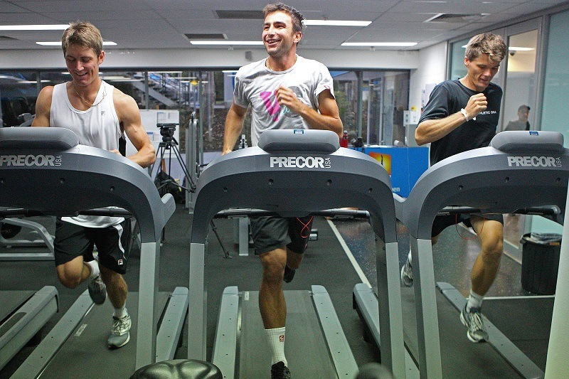 Three men hit the treadmill at the gym