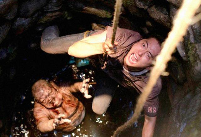Glenn tries to get away from the walker in the well in 'The Walking Dead'