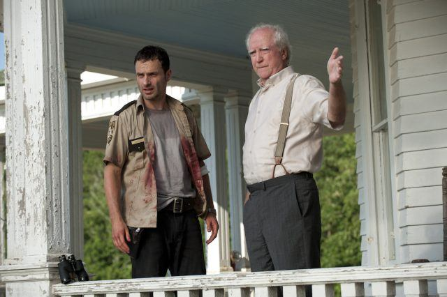 Rick (Andrew Lincoln) and Hershel (Scott Wilson) stand on the farmhouse porch in a scene from Season 2 of 'The Walking Dead'