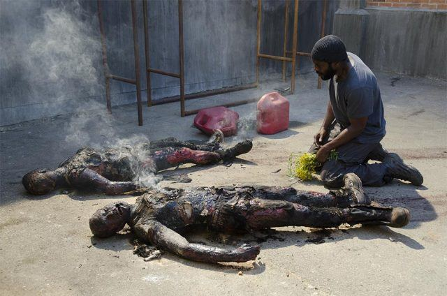 Tyreese (Chad L. Coleman) looks at the burned bodies of his friends in a scene from the 'Walking Dead' Season 4 episode, 'Infected'