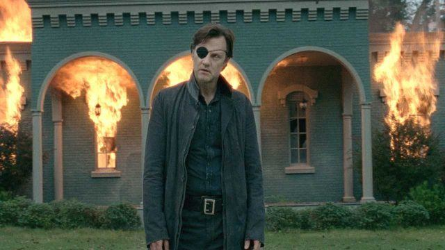 The Governor (David Morrissey) stands in front of a burning building in a scene from 'The Walking Dead' episode 'Live Bait'