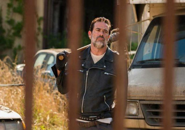 Negan, with Lucille slung over his shoulder, walks toward the Alexandria gates in a scene from 'The Walking Dead' Season 7.