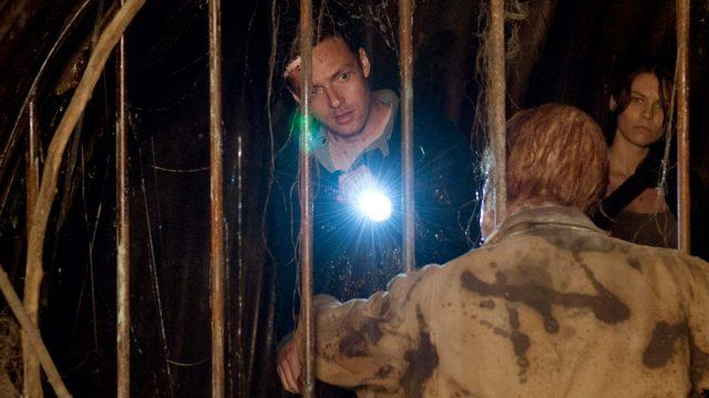 Aaron (Ross Marquand) and Maggie (Lauren Cohan) encounter a walker in a grate in a scene from 'The Walking Dead' Season 6 episode, 'Now'