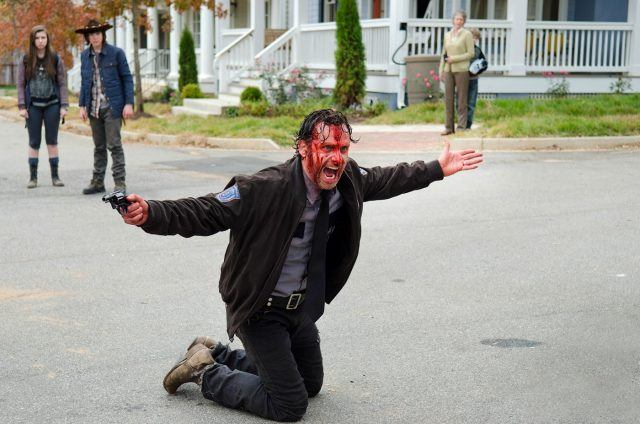 Rick, face covered in blood, holds his arms out and screams in a scene from 'The Walking Dead' episode 'Try'