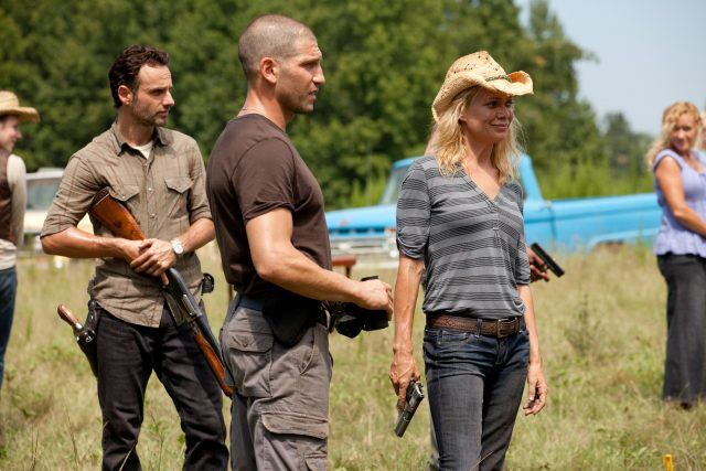 Rick, Shane and Andrea stand holding their weapons in a scene from 'The Walking Dead' Season 2 episode 'Secrets'