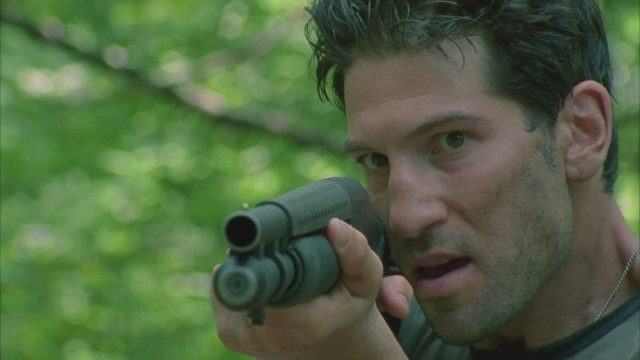 Shane (Jon Bernthal) aims his weapon in a scene from 'The Walking Dead'
